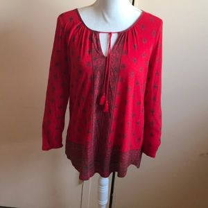 A beautiful red long sleeve shirt